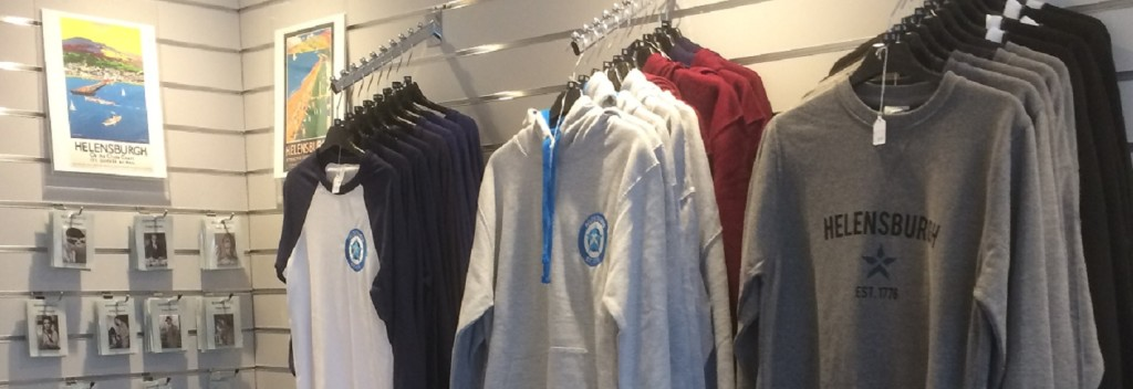 Helensburgh Heroes Centre Shop display of sweatshirts and teeshirts